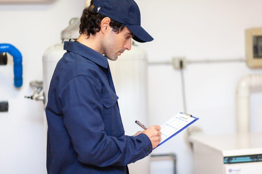 Technician servicing hot water plumbing services