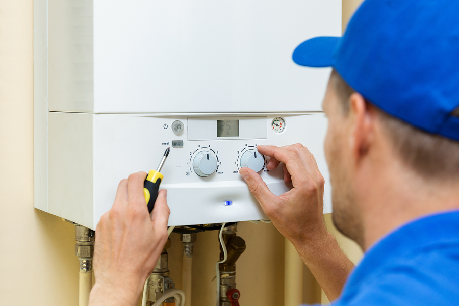 Hot water plumber in Canberra working