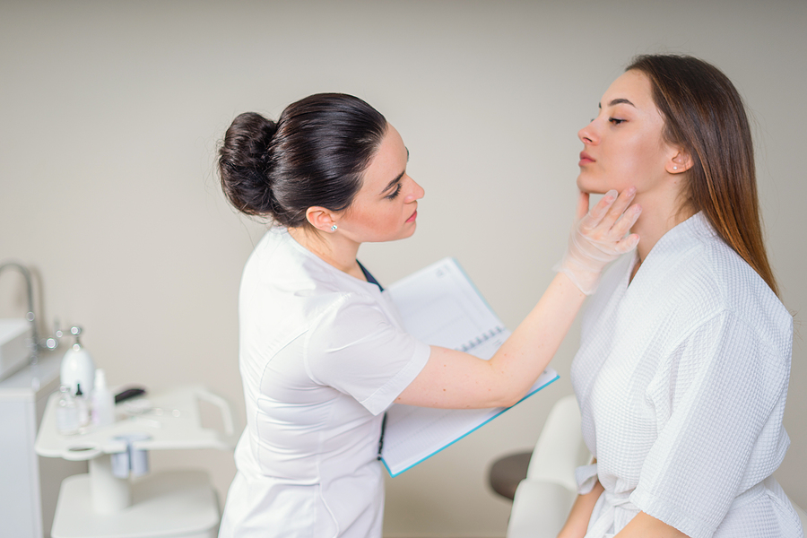 Woman getting her skin checked at a skin clinic in Melbourne